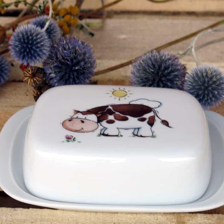 Butterdose mit Kuh und Sonne