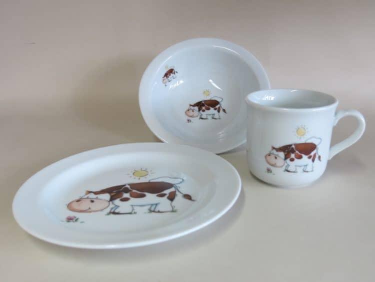 Geschirrset mit Müslischüssel Teller und Kinderbecher mit Kuh und Sonne