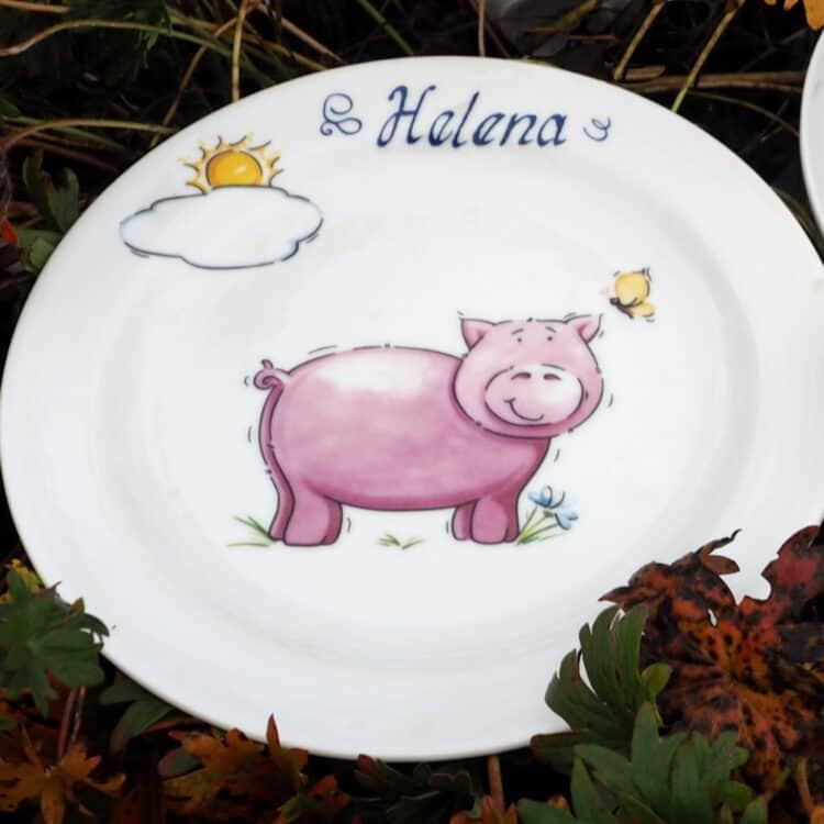 Frühstücksteller aus Porzellan mit Schweinchen in rosa und Namen