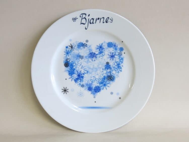 Teller Opty 21, 5 cm mit blauem Winterherz Herz aus Schneeflocken.