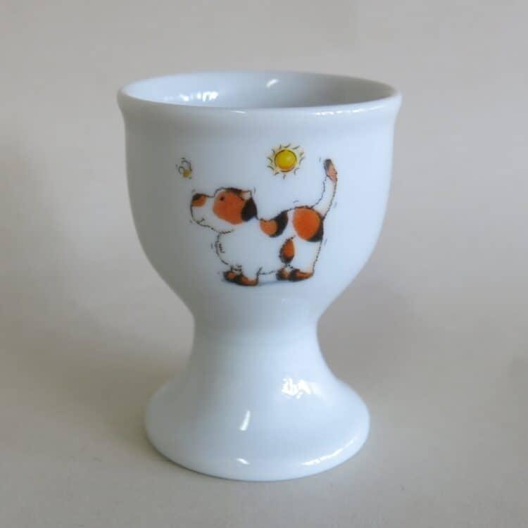 Eierbecher aus Porzellan mit Hund Bienchen und Sonne