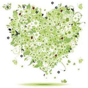 Grünes Herz aus Blumen auf Porzellan