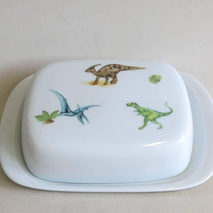 Porzellan Butterdose 250g König mit bunten Dinosauriern zu